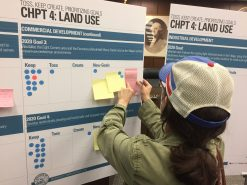 A resident tapes up a suggestion for new goals regarding land use planning. | BOB UPHUES/Editor