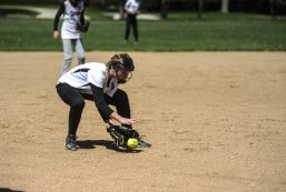 Natalie Sinese picks up a ground ball during the Riverside Little League softball game at Big Ball Park on Longcommon Road. | William Camargo/Staff Photographer