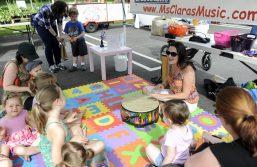 Clara D'Onofrio teaches a children's music class during the Brookfield Farmers Market on June 3. | William Camargo/Staff Photographer