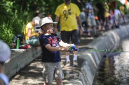 Stanley Tokarz casts his line into the Des Plaines River from the bank in Swan Pond Park in Riverside during the Recreation Department's first-ever kids' fishing derby on June 11. About 40 kids and their parents showed up to fish on a day where temperatures reached into the 90s. | William Camargo/Staff Photographer