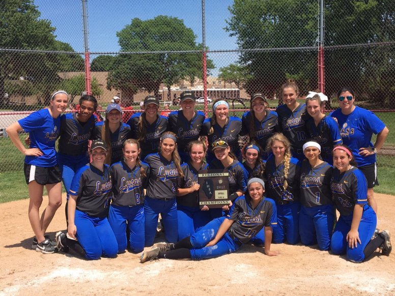 The LTHS softball team, shown here celebrating its regional championship win and plaque, improved throughout the season en route to 20 wins and a sectional finals appearance under first-year head coach Nikki Marinec. | Courtesy Lyons Township Softball/Twitter