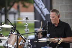 Mike Gallus of ARRA jams out during the first summer concerts at Kiwanis Park on June 23. | William Camargo/Staff Photographer