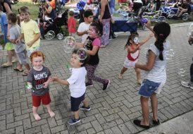 Kids chase after bubbles while waiting for the music to start at Brookfield Zoo's Summer Nights concert on Friday, June 30. | William Camargo/Staff Photographer