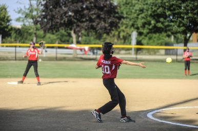 Shortstop Bryce Pacourek of Riverside Little League's 12-U softball makes a quick play during the game against LaGrange on July 7 at Veterans Park in North Riverside. | William Camargo/Staff Photographer