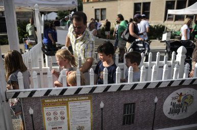 Children wait in line to ride the train during the RiverFest in downtown Riverside on July 22.   William Camargo/Staff Photographer