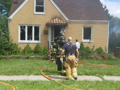 A team of firefighters ran one hose line through the front of the home to extinguish the fire inside while a second team put out the fire in back. | Courtesy of North Riverside Firefighters Union 2714