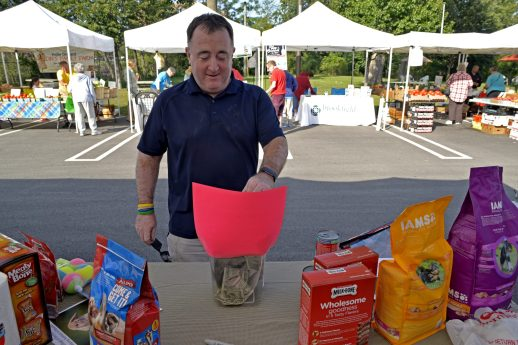 Village trustee Mike Garvey donates cash on Sept. 2, for Hurricane Harvey victims during the Brookfield farmers market at Village Hall in Brookfield. | Alexa Rogals/Staff Photographer
