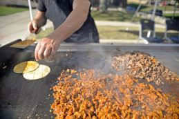 A cook from Tacqueria Coral out of Bolingbrook, makes al pastor tacos during the Latin Music Fest on Sept. 9. | Alexa Rogals/Staff Photographer
