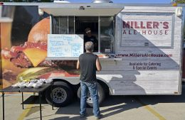 Attendees purchase food from Miller's Ale House food truck during the Latin Music Fest, organized by the Hispanic Organization of North Riverside (HONR) on Sept. 9 at the Village Commons. | Alexa Rogals/Staff Photographer