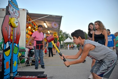 North Riverside's Autumn Fest on Sept. 15 drew more than 2,500 people, such as Jake Dudcik, 8, who of the hammer to ring the bell at the carnival. | Alexa Rogals/Staff Photographer