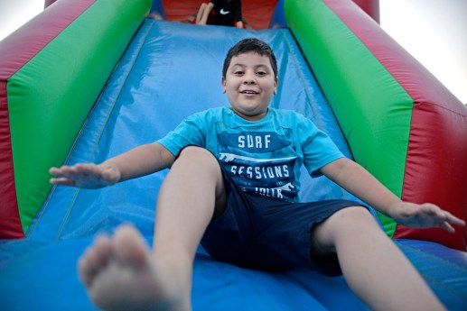 Leo Herrera, 8 takes a ride down the inflatable slide. | Alexa Rogals/Staff Photographer