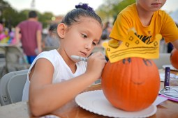 Ava Runquist, 6, of North Riverside, decorates a donated pumpkin. | Alexa Rogals/Staff Photographer