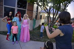 Children take photos with super hero and Disney characters on Sept. 15, during North Riverside's Autumn Fest. | Alexa Rogals/Staff Photographer