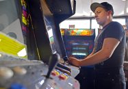 Juan Velazquez, of Chicago, plays Mortal Kombat at Galloping Ghost Arcade on Sept. 25. The iconic street-fighting game was the inspiration for Doc Mack's game Dark Presence, which ought to be complete soon, he said, after two-plus decades in production. | Alexa Rogals/Staff Photographer