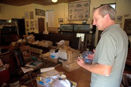 Kit Ketchmark, director of the Brookfield Historical Society, points out the boxes of yet-to-be-archived items donated after the 2016 death of village historian Chris Stach. | Alexa Rogals/Staff Photographer