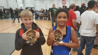 Bulldog Wrestling Club members Ben Lupfer and Danea Vargas proudly display their championship plaques they won at a tournament. (Courtesy Tom Lupfer)
