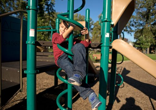 Michael Kulikauskas, 7, of Brookfield, plays on the jungle gym on Monday, Oct. 16, after school at the Kiwanis Park playground in Brookfield.   Alexa Rogals/Staff Photographer