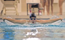 RBHS varsity swimmer Chloe Marrello competes in the 100-yard butterfly on Thursday, Oct. 12, 2017, during a girls swim meet against Chicago Latin at Riverside-Brookfield High School. (Alexa Rogals/Staff Photographer)