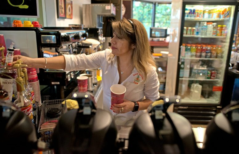Loca Mocha owner Maria Verduzco mixes up a beverage at the coffee shop's new location inside the Brookfield Metra station on Oct. 23. The store moved to the south side of the tracks after a 14-year run at a storefront on Brookfield Avenue, which will soon be home to another caf?.   Alexa Rogals/Staff Photographer