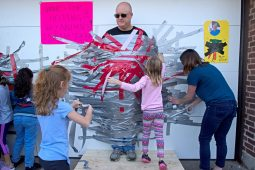 Students and members of the Parent-Teacher Organization, duct tape principal Peter Gatz on Oct. 20, at Central Elementary School in Riverside. | Alexa Rogals/Staff Photographer