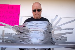 Principal Peter Gatz gets duct taped on Oct. 20, 2017, during a fundraiser for animals in Puerto Rico at Central Elementary School in Riverside. | Alexa Rogals/Staff Photographer