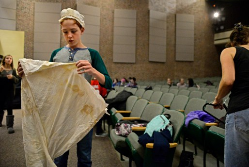 """Cast members get dressed for a scene on Nov. 2, during play rehearsals for """"A Christmas Carol"""" at L.J. Hauser Junior High School in Riverside. 