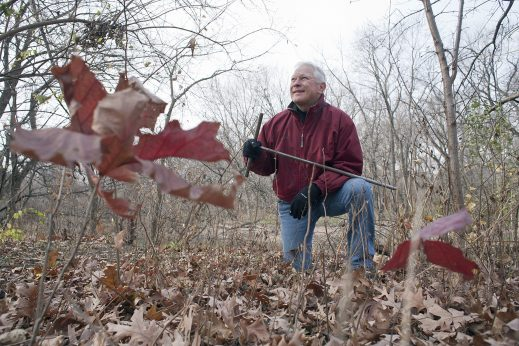 Volunteers are needed for the 11th Annual 1,000 Tree Planting Project, which will happen Saturday, Nov. 18 from 10 a.m. to 3:30 p.m. along the wooded areas of the Des Plaines River in Riverside. Tom Sisulak (above), between two young oak trees he planted near the edge of the Des Plaines River in Riverside in 2014.