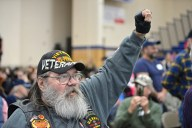RBHS Alumnus and U.S. Navy veteran Dennis Wood, of Brookfield, cheers while music plays on Nov. 10, during the annual Veteran's Day assembly inside the gymnasium at Riverside Brookfield High School. | Alexa Rogals/Staff Photographer