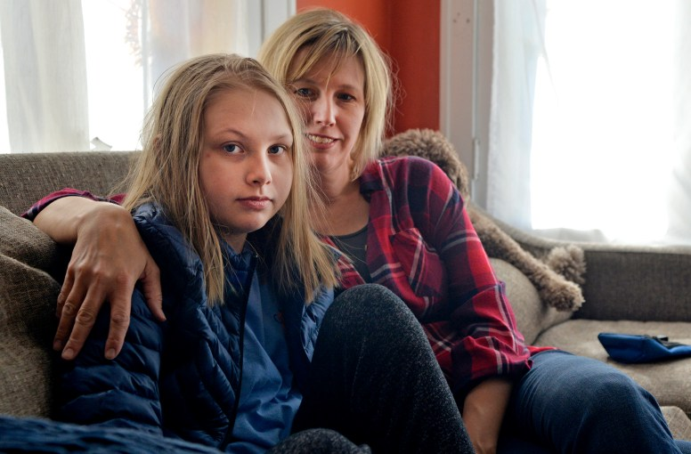 Lizzie Mooney, 12, has battled the symptoms of ME since she was 9, suffering the condition's physical and emotional toll. Her mom, Amy (at right), is determined to raise awareness of the condition, which can strike at any time. | Alexa Rogals/Staff Photographer