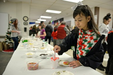 Lizlolly Martinez, 8, of Brookfield, decorates a sugar cookie at Village Hall on Dec. 2, during the annual Holiday Walk and celebration throughout Brookfield. | ALEXA ROGALS/Staff Photographer