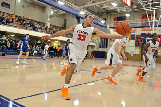 OPRF's Craig Shelton (33) grabs a rebound on Friday, Dec. 8, 2017, during a varsity basketball game against Lyons Township in the field house at Oak Park and River Forest High School. | ALEXA ROGALS/Staff Photographer
