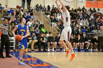 LT's Nolan Niego (3) looks to pass the ball on Friday, Dec. 8, 2017, during a varsity basketball game against OPRF in the field house at Oak Park and River Forest High School. | ALEXA ROGALS/Staff Photographer