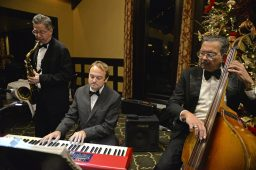 Members of the Peter Oprisko Quintette perform for attendees on Dec. 10, during the Riverside Dancing Club's Winter Dance at Edgewood Valley Country Club in La Grange. | Alexa Rogals/Staff Photographer