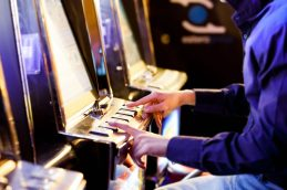 Man having playing an electronic slot machine
