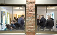 Attendees check out the different pieces of art on Jan. 5, during the opening night and first exhibition at Compassion Factory Art Gallery in Brookfield. | Alexa Rogals/Staff Photographer
