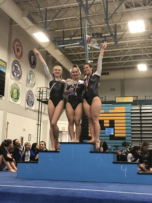 RBHS gymnasts Savannah Bishop, Mia Giurini and Amber O'Brien at a meet this season. (Courtesy of Karyn Domzalski)