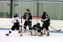Fenwick goalie Lena Flores (#50) makes a save with Ava Gawley (#19) and Erin Proctor (#18) defending. All three players earned All-State honors this season. (File photo)