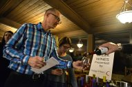 Peter Janunas, left, of Riverside, and his wife, Lisa, get a sample of wine on Feb. 3 during the Between The Wines fundraiser event at Riverside Public Library. | Alexa Rogals/Staff Photographer