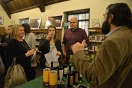 Those in attendee sample different types of wine throughout the building on Feb. 3 during the Between The Wines fundraiser event at Riverside Public Library. | Alexa Rogals/Staff Photographer