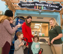 Lauren Reeder (far right), an inclusion specialist at Brookfield Zoo, is available to families to help facilitate the unique and individual needs of families. | Courtesy of Chicago Zoological Society