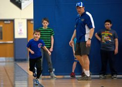 Attendees run sprints on Feb. 17, during assessments in the field house at Riverside Brookfield High School. | Alexa Rogals/Staff Photographer