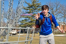 Sam Fletcher, a senior at Riverside-Brookfield High School, takes advantage of a break in the weather to play a little disc golf with family members on Sunday, March 4 in Kiwanis Park in Brookfield. | Alexa Rogals/Staff Photographer