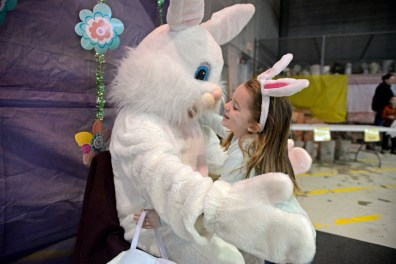 Brielle Mikulich, 4, of Downers Grove, hugs the Easter bunny before taking a photo on March 24, inside the Riverside Public Works facility in Riverside Lawn for the village's annual Easter Egg Hunt. | Alexa Rogals/Staff photographer