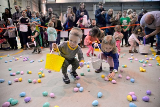 Participants race to fill their baskets on March 24, inside the Riverside Public Works facility in Riverside Lawn for the village's annual Easter Egg Hunt. | Alexa Rogals/Staff photographer