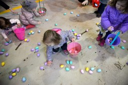Children pick up Easter eggs on March 24, inside the Riverside Public Works facility in Riverside Lawn for the village's annual Easter Egg Hunt. | Alexa Rogals/Staff photographer