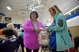 Patti Bzdyl, left, and Joan Halvey, both of North Riverside, sell raffle tickets to attendees on March 23, during Bunny Bingo at the Village Commons in North Riverside. | Alexa Rogals/Staff photographer