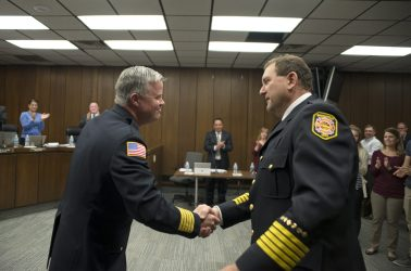 Outgoing fire chief Patrick Lenzi, left, shakes hands with incoming chief Mark Duffek on April 23, during a Village Board meeting at Brookfield Village Hall. | Alexa Rogals/Staff Photographer