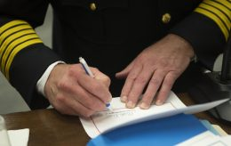 Mark Duffek signs his name after being sworn in as the new fire chief on April 23, during a Village Board meeting at Brookfield Village Hall. | Alexa Rogals/Staff Photographer