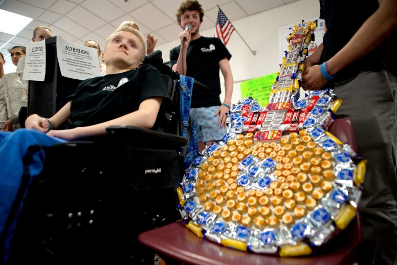 A rocker at heart, Ethan Tkalec (left) gets ready to pick the winning ticket for a candy guitar, raffled off by fellow RBHS students and faculty to help raise funds to offset the cost of his medical care, during a daylong tribute last Friday to the 14-year-old freshman who underwent surgery on May 1. | Alexa Rogals/Staff Photographer