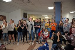 Students and faculty cheer on Ethan Tkalec together April 27, during lunch inside the cafeteria at Riverside Brookfield High School. | Alexa Rogals/Staff Photographer